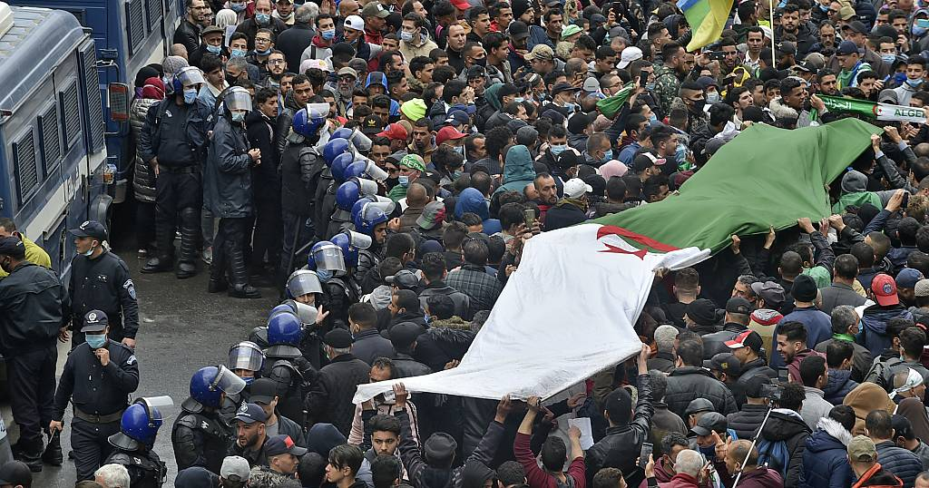 Thousands of Algerians hit streets on protest anniversary