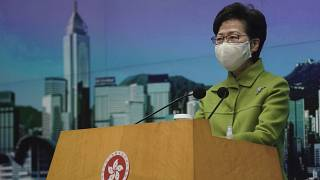 In this Jan. 26, 2021, file photo, Hong Kong Chief Executive Carrie Lam listens to reporters' questions during a press conference in Hong Kong.