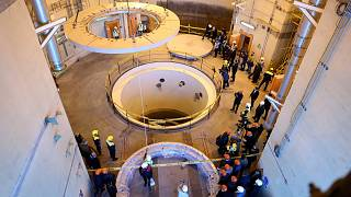 Technicians work at the Arak heavy water reactor's secondary circuit in Iran