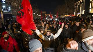 Supporters of the left-wing Self-Determination Movement party react in Pristina, the capitol of Kosovo, on Sunday, Feb. 14, 2021.