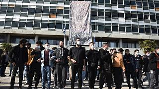 Protesters chant slogans at the University of Thessaloniki in northern Greece, on Monday, Feb. 22, 2021
