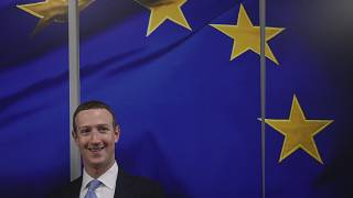 Facebook CEO Mark Zuckerberg smiles as he shakes hands prior to a meeting with European Commissioner for Values and Transparency Vera Jourova in Brussels - Feb 2020