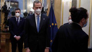 Spain's King Felipe, centre, smiles after greeting Spain's second deputy Prime Minister Pablo Iglesias, right as Spain's Premier Pedro Sanchez, left, looks on. Feb 23 2021
