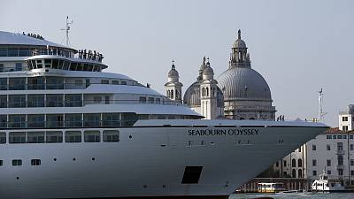 A cruise ship manoeuvres through the Giudecca canal in front of St. Mark's Square, in Venice, Italy.