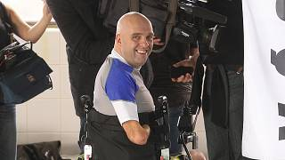 Limbless Philippe Croizon from France, smiles, after he set a world record to scuba dive 33 meters deep in Brussels, Thursday, Jan. 10, 2013.