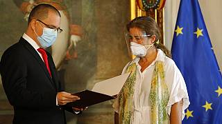 "European Union Ambassador to Venezuela Isabel Brilhante Pedrosa is presented with a letter of ""persona non grata"" from Venezuelan Foreign Minister Jorge Arreaza in Caracas."