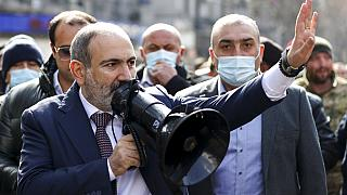 Armenian Prime Minister Nikol Pashinyan speaks through a loudspeaker during a rally in the central in Yerevan, Armenia,