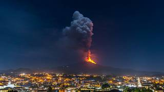 Flames and smoke billowing from a crater of the Mount Etna volcano, Sicily. February 24, 2021