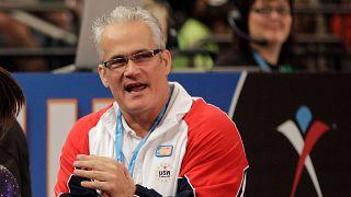2012 file photo of gymnastics coach John Geddert