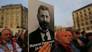 Protesters hold portraits of Armenian intellectuals during a rally to commemorate the anniversary of the 1915 mass killings.