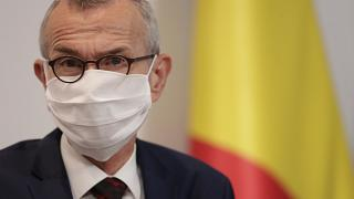Belgium's Minister of Health and Social Affairs Frank Vandenbroucke wears a facemask during an October press conference.