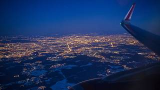 The Illuminated city of Moscow seen through the window of an aircraft coming in to land at Sheremetyevo airport outside Moscow, Russia.