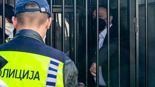 Sasho Mijalkov waits in a police van before he was sentenced at the criminal court.