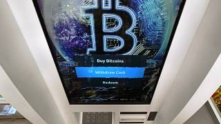 The Bitcoin logo appears on the display screen of a crypto currency ATM at the Smoker's Choice store, Tuesday, Feb. 9, 2021.