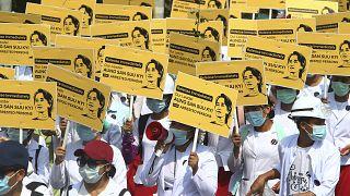 Medicals students display images of deposed Myanmar leader Aung San Suu Kyi during a street march in Mandalay, Myanmar, Friday, Feb. 26, 2021.