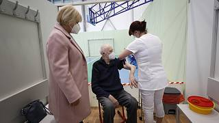 An elderly man receives Moderna COVID-19 vaccine at a sports hall in Ricany, Czech Republic, Friday, Feb. 26, 2021.
