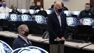 President Joe Biden tours the Harris County Emergency Operations Center with Texas Gov. Greg Abbott, Friday, Feb. 26, 2021, in Houston.