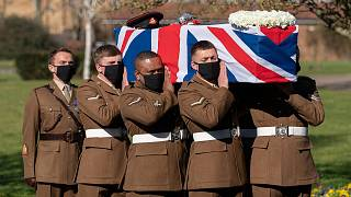 Soldiers from the British Army's Yorkshire Regiment carry the coffin of Captain Tom Moore during his funeral service at Bedford Crematorium.