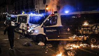 A police van burns after being attacked by demonstrators during a protest condemning the arrest of rap singer Pablo Hasél in Barcelona, Spain, Saturday, Feb. 27, 2021.