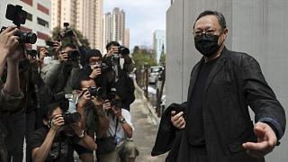 Former law professor Benny Tai, who was arrested under Hong Kong's national security law, walking to a police station in Hong Kong Sunday, Feb. 28, 2021.