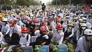 Protesters shout slogans during a protest against the military coup in Mandalay, Myanmar, Sunday, Feb. 28, 2021.