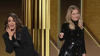 Tina Fey, left, from New York, and Amy Poehler, from Beverly Hills, Calif., speak at the Golden Globe Awards on Feb. 28, 2021.