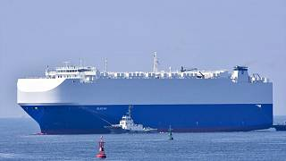 In this Aug. 14, 2020, photo, the vehicle cargo ship Helios Ray is seen at the Port of Chiba in Chiba, Japan.