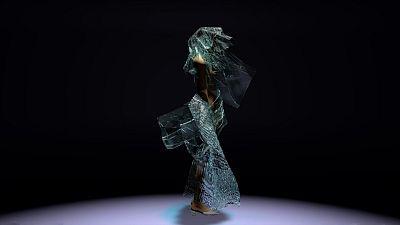 3D model wearing a dress made from algae designed by Scarlett Yang.