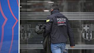 A policeman enters the offices of the Barcelona Football Club on March 01, 2021 in Barcelona during a police operation inside the building
