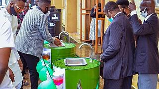 Nigerians fight COVID-19 by turning drums into handwashing basins