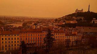 A view of Lyon, France, taken on February 6, 2021, as dust from the Saharan coloured the sky red.