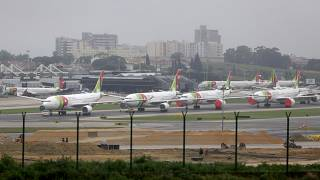 TAP Air Portugal airplanes lined up at Lisbon's airport