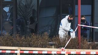 Forensic investigators search for evidence after an explosion at a Covid-19 testing centre in the town of Bovenkarpsel