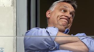 In this May 19, 2019 file photo, Hungarian Prime Minister Viktor Orban watches a soccer game in his hometown of Felcsut, Hungary.