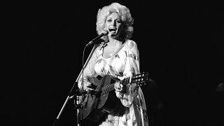 Dolly Parton performs during her Tokyo concert on Monday, July 30, 1979. (AP Photo/Tsugufumi Matsumoto)