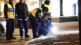 Police are seen in the area after several people were attacked in Vetlanda, Sweden, Wednesday, March 3, 2021