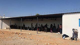 Survivors wait outside the Migrant Response Centre in Obock, Djibouti - IOM