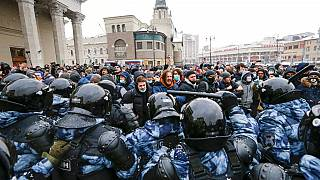 Jan. 31, 2021 file photo, people clash with police during a protest against the jailing of opposition leader Alexei Navalny in Moscow, Russia.