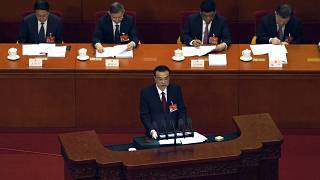 Chinese Premier Li Keqiang delivers a speech during China's National People's Congress (NPC) at the Great Hall of the People in Beijing, Friday, March 5, 2021.
