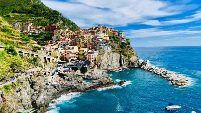 Cinque Terre is a series of centuries-old seaside villages on the rugged Italian Riviera coastline.