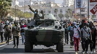 Senegalese troops arrive to assist police during protests against the arrest of opposition leader Ousmane Sonko in Dakar, Senegal, Friday, March 5, 2021.