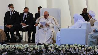 Pope Francis, center, speaks during an interreligious meeting near the archaeological site of Ur near Nasiriyah, Iraq