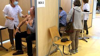A man receives a Pfizer/BioNTech vaccine against the COVID-19 in a vaccination center of Bayonne, southwestern France.
