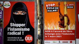 ملصق يدعم مبادرة لحظر تغطية الوجه في سويسرا. 2021/02/16