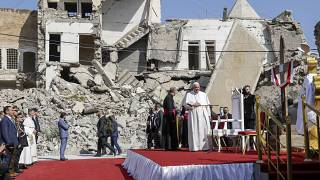 Pope Francis, surrounded by shells of destroyed churches, arrives to pray for the victims of war at Hosh al-Bieaa Church Square, in Mosul, Iraq.