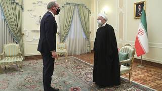 Iranian President Hassan Rouhani, right, and Irish Foreign Minister Simon Coveney greet at the start of their meeting in Tehran, Iran, Sunday, March 7, 2021.