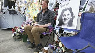 Richard Ratcliffe, the husband of detained Nazanin Zaghari Ratcliffe, seen in poster, outside the Iranian Embassy in London, Saturday June 29, 2019