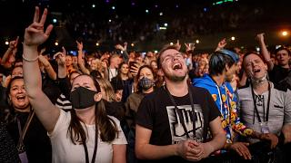 Visitors to the Ziggo Dome attend a performance by Dutch musician Phil Bee in Amsterdam on March 7 2021.