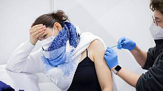 AstraZeneca's vaccine is administered by a doctor in Koelnmesse, Cologne.