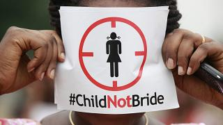 A woman protests against underage marriage in Lagos, Nigeria on July 20, 2013.